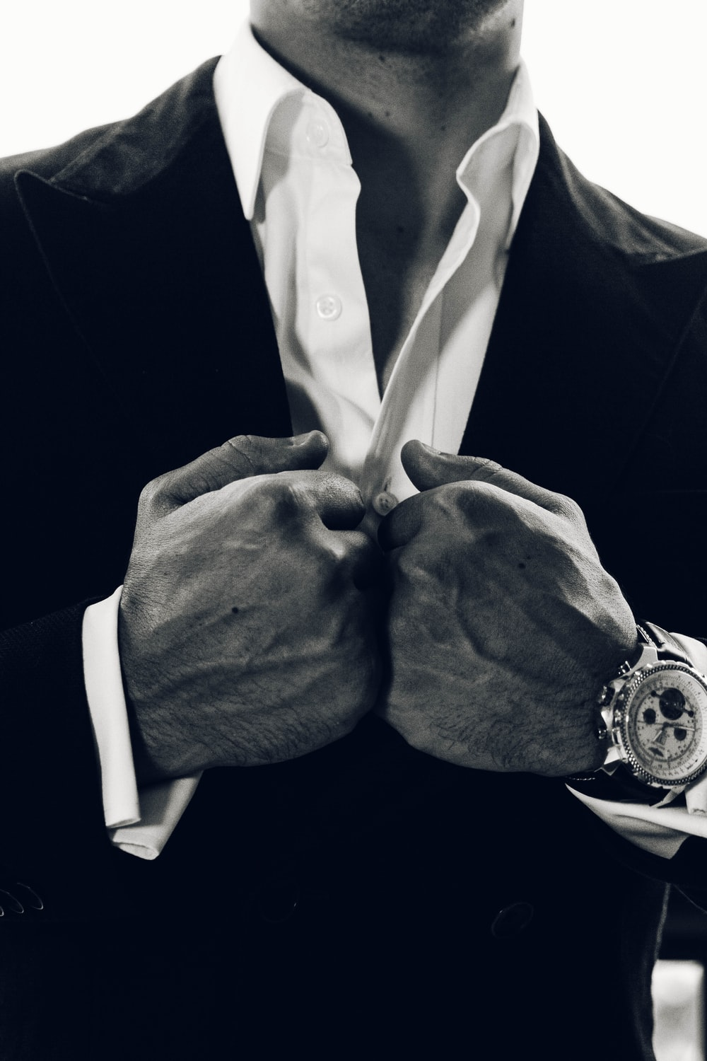 grayscale photography of man's suit