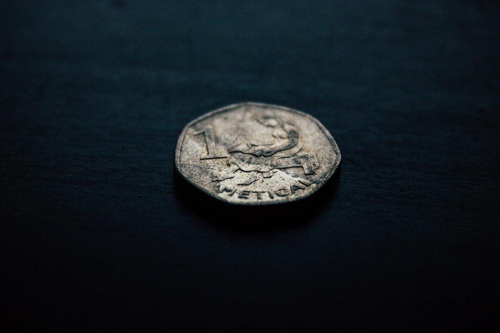 silver-colored coin