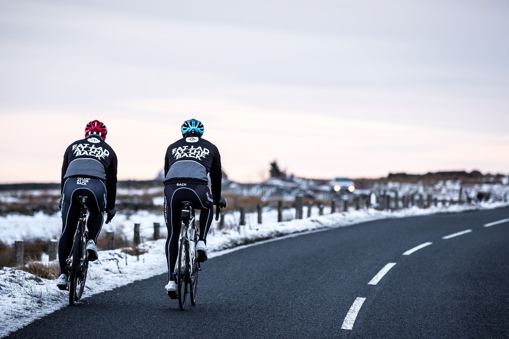 two cyclist on road