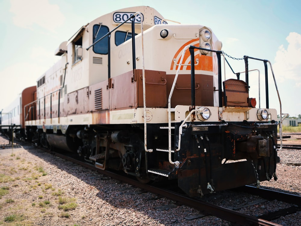 white and brown train at daytime