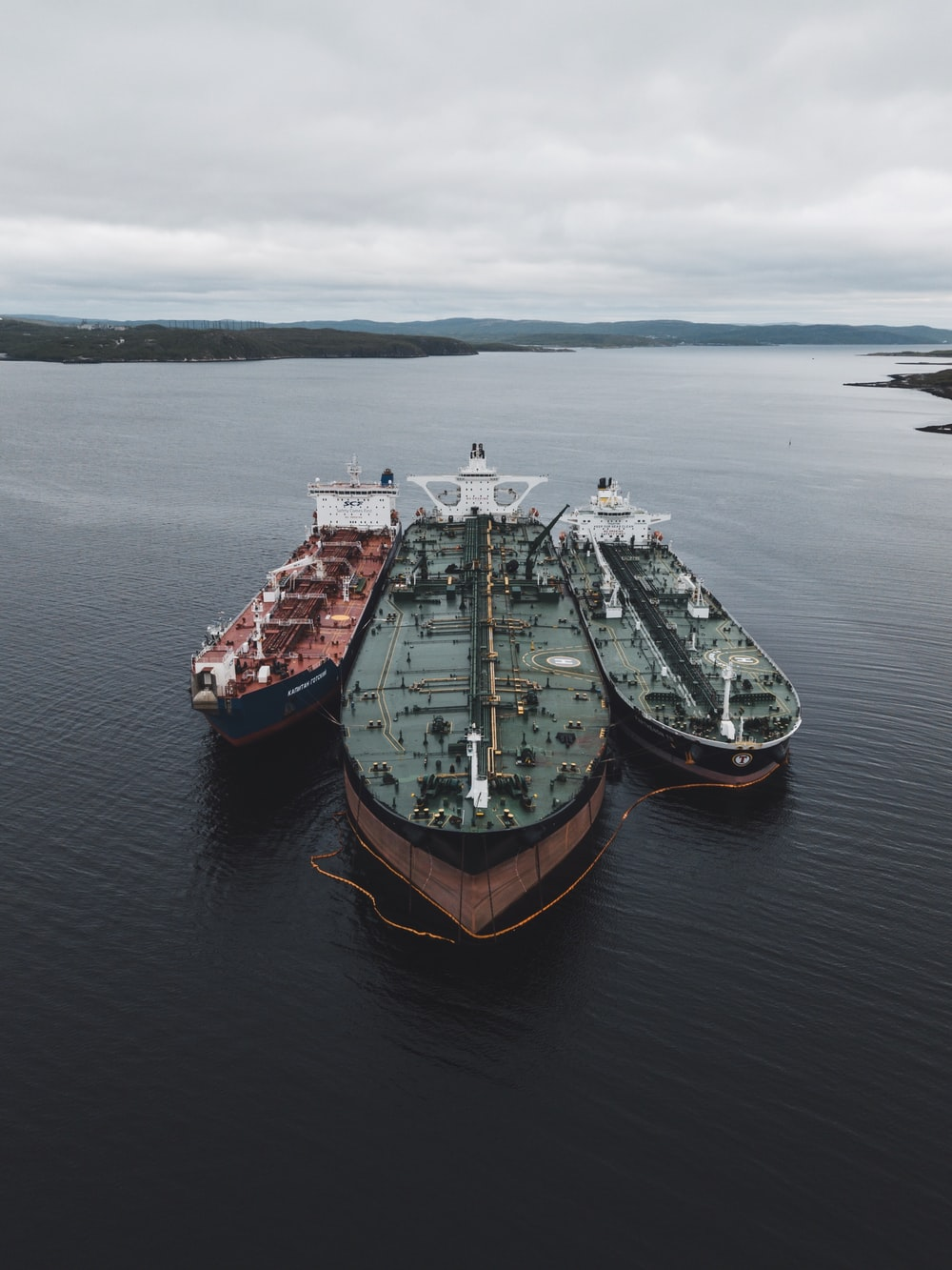 black and brown ships under cloudy sky