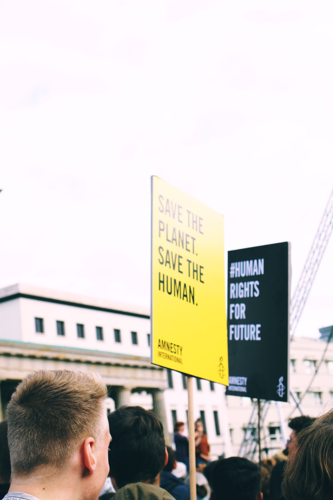 A young man in Berlin protests for planet and environment care.