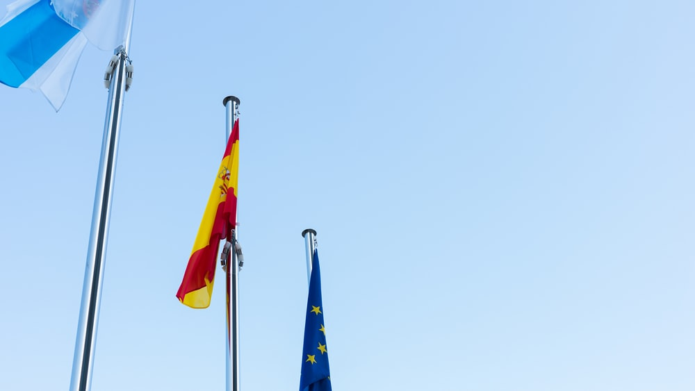 low-angle photography of three country flags