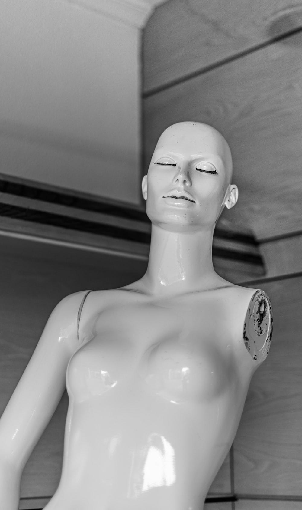 white plastic woman mannequin