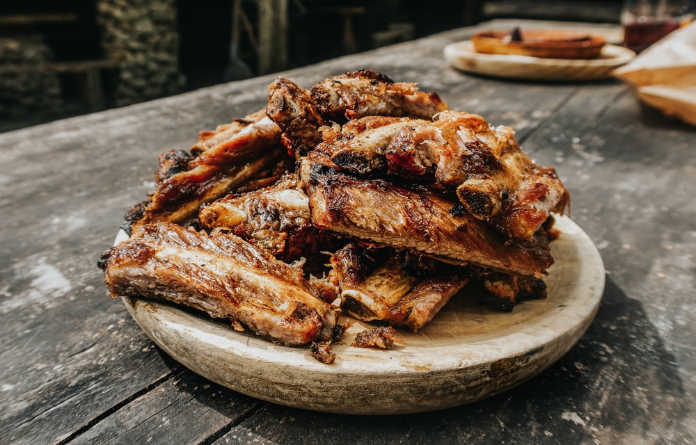 grilled ribs on brown wooden tray