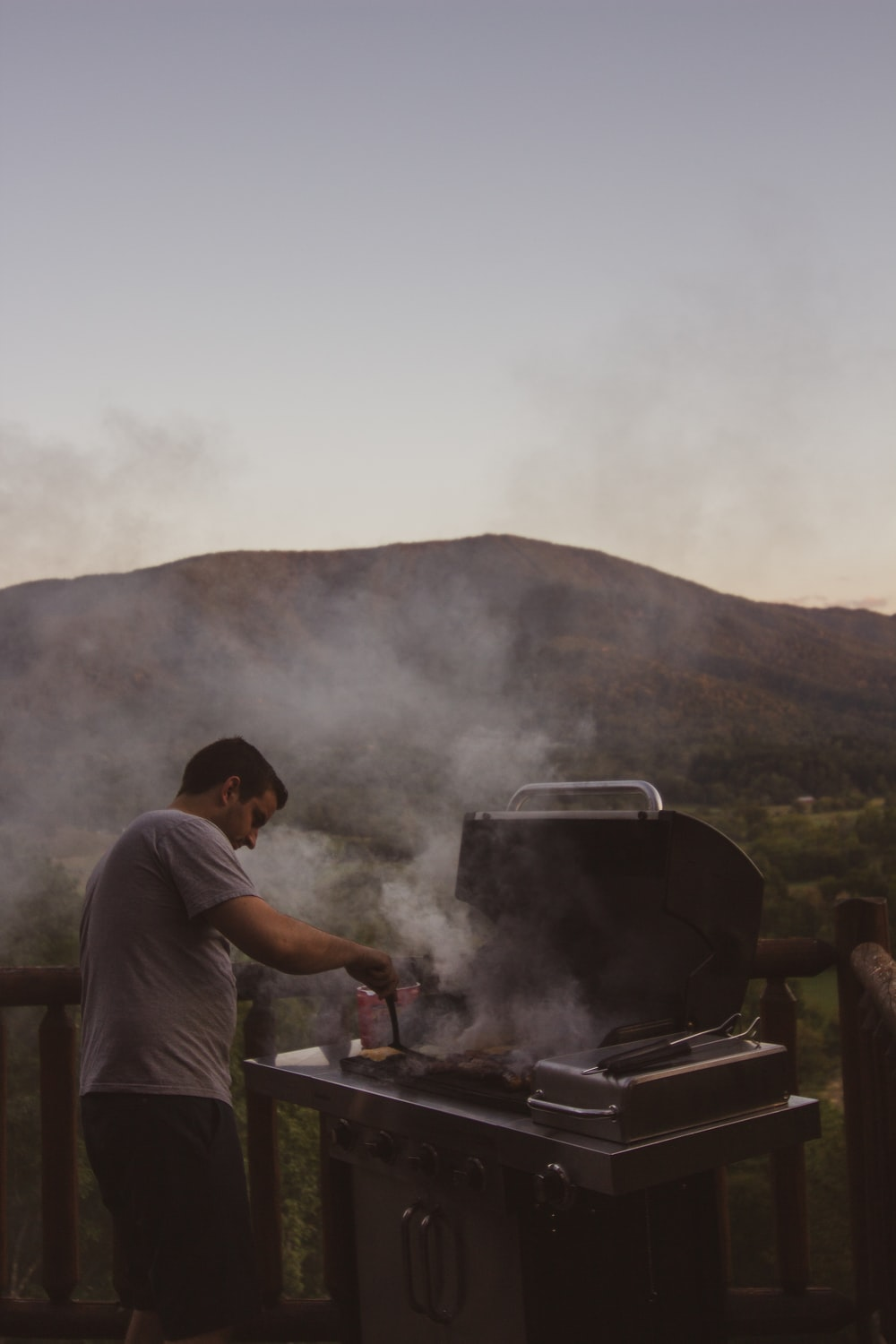 man cooking on charcoal grill