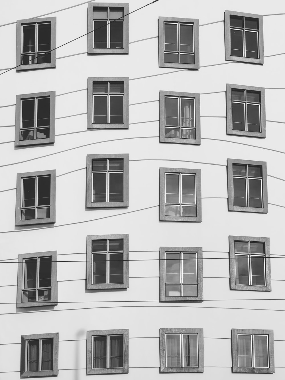 grayscale photo of buildings windows