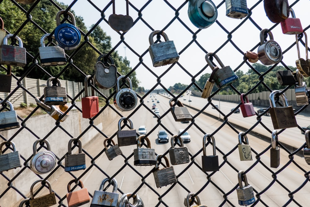padlocks on chain-link fence