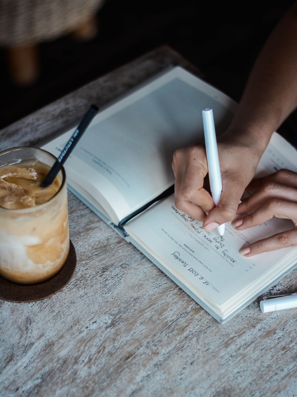 person writing on book
