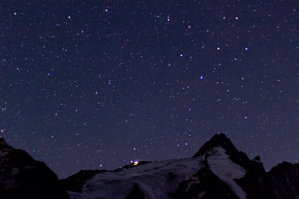 view of starry night at the mountain