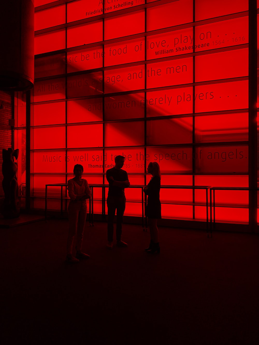 silhouette photography of three people inside a building