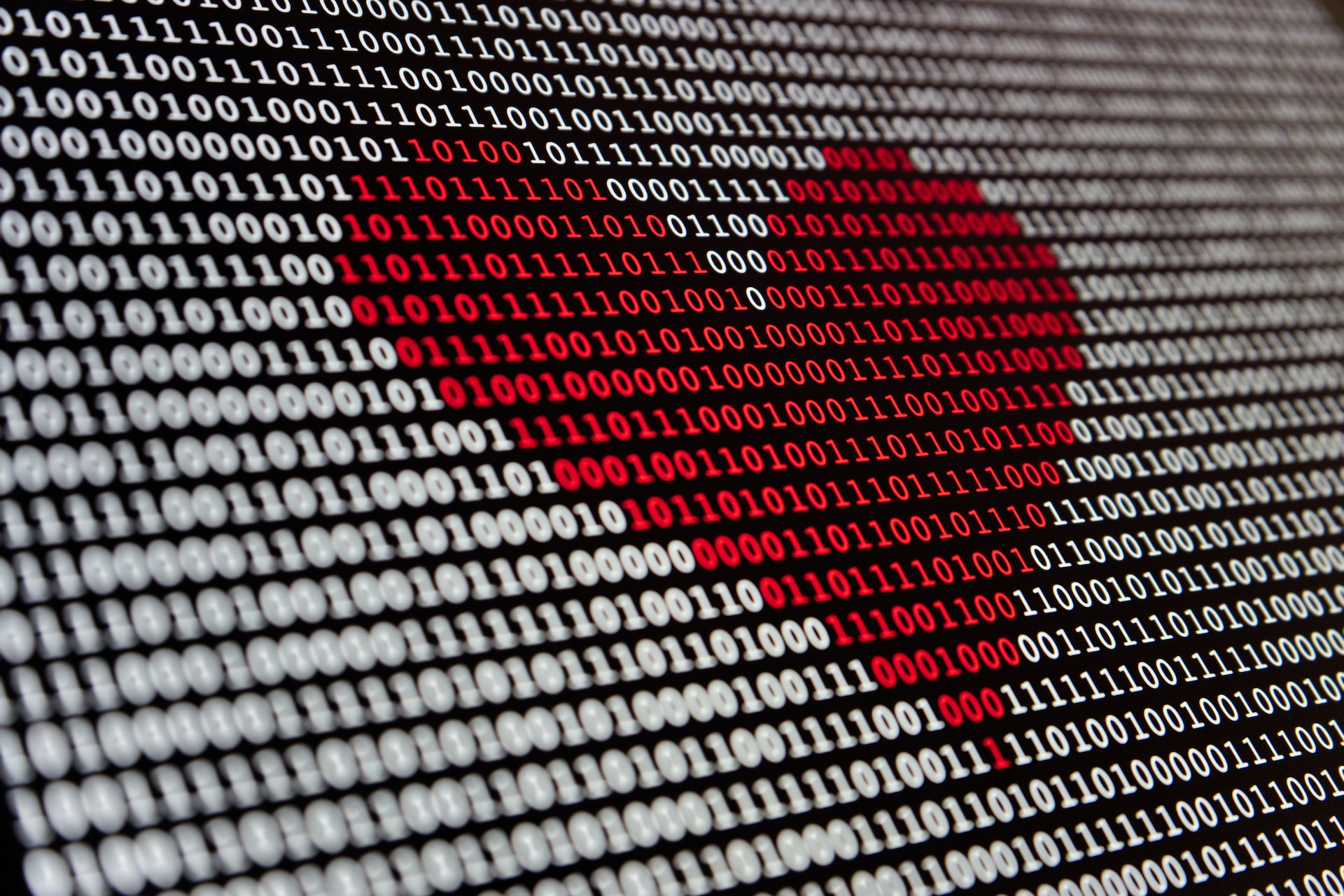 Red heart made out of binary digits