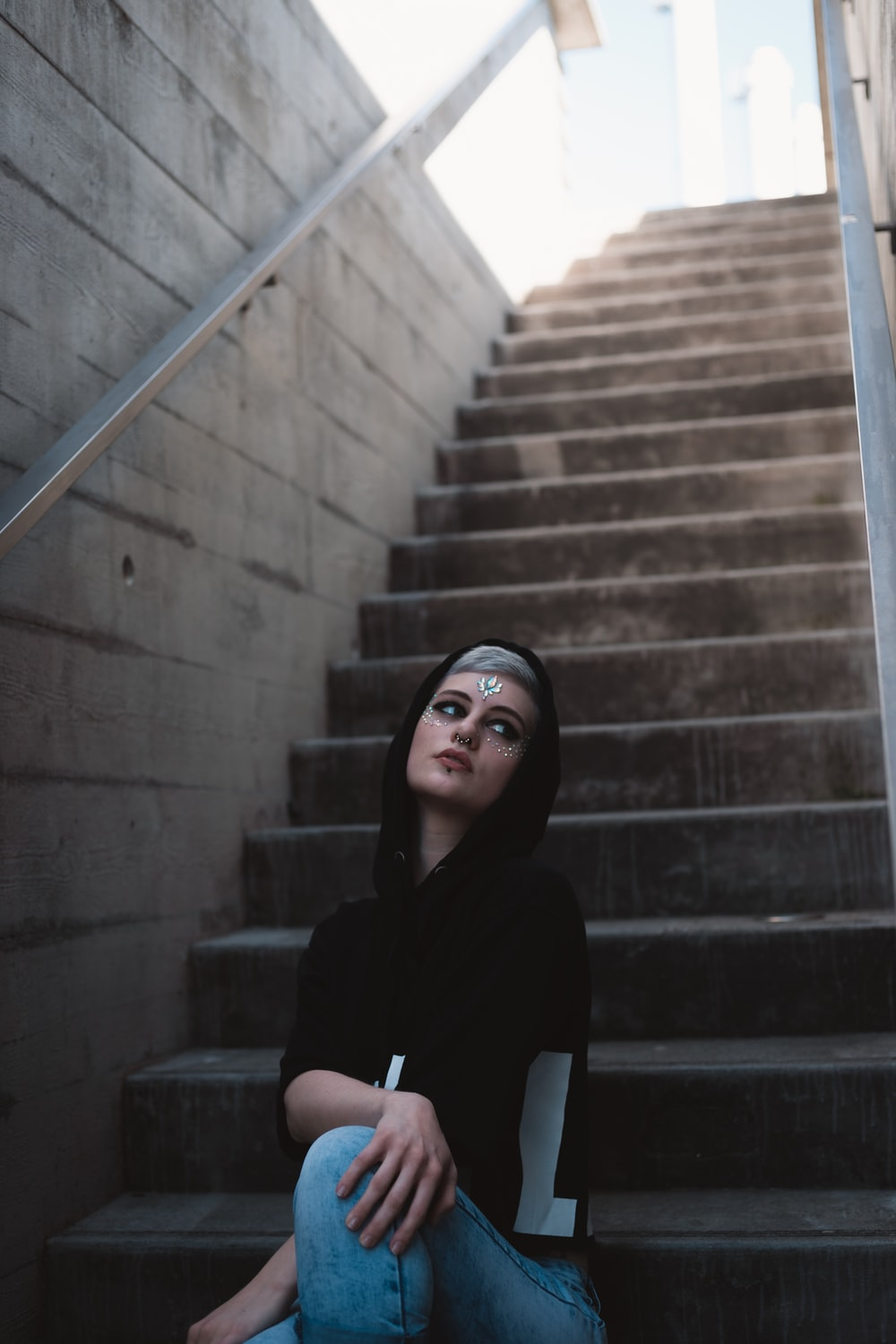 woman sits on stairs