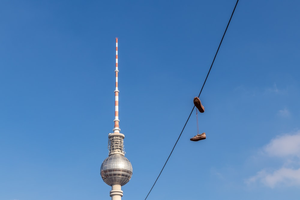 pair of brown shoes on cable wire