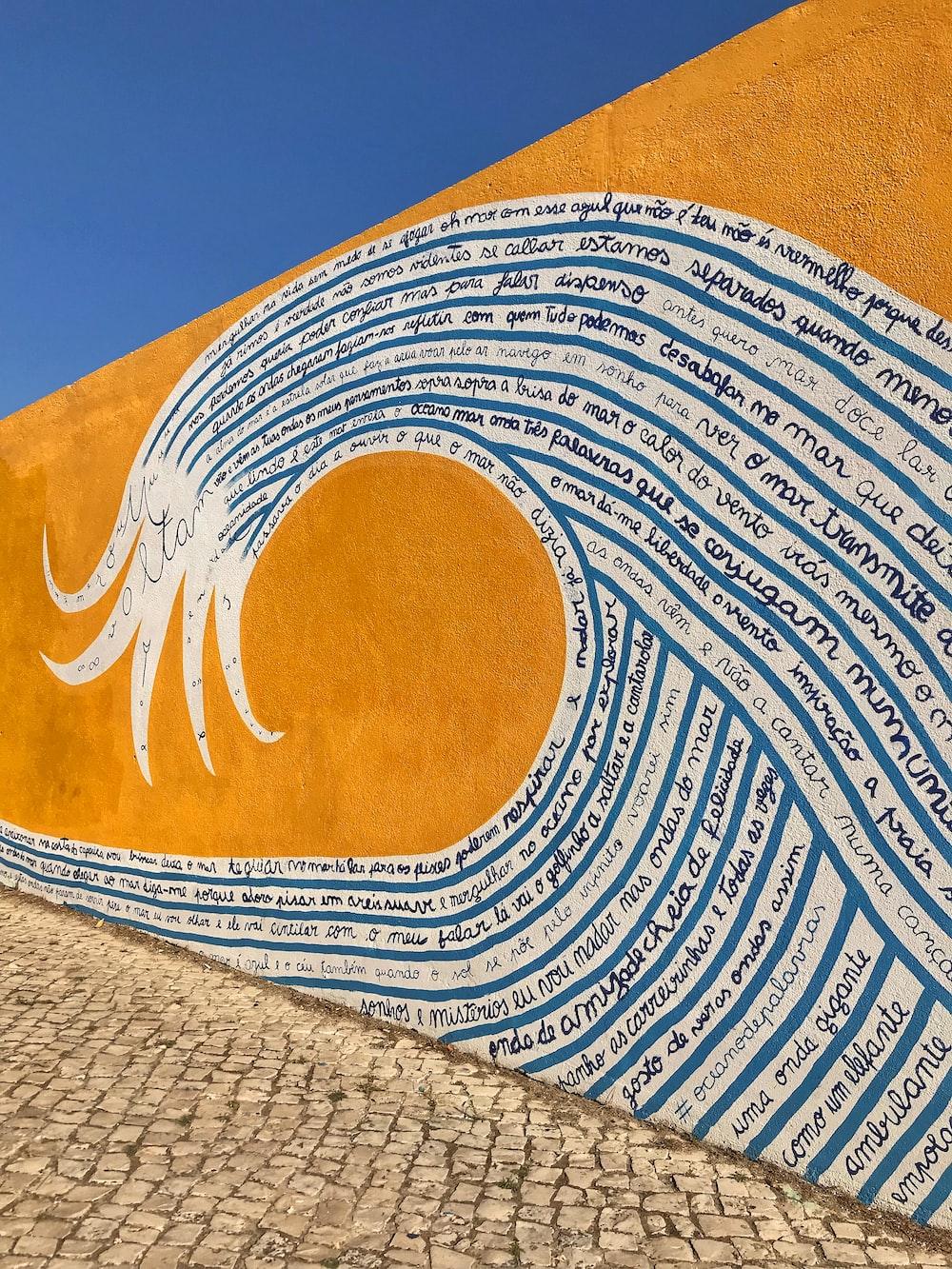 orange, blue, and white wave art
