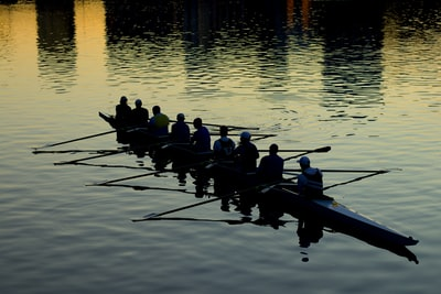 men rowing boat collaboration teams background