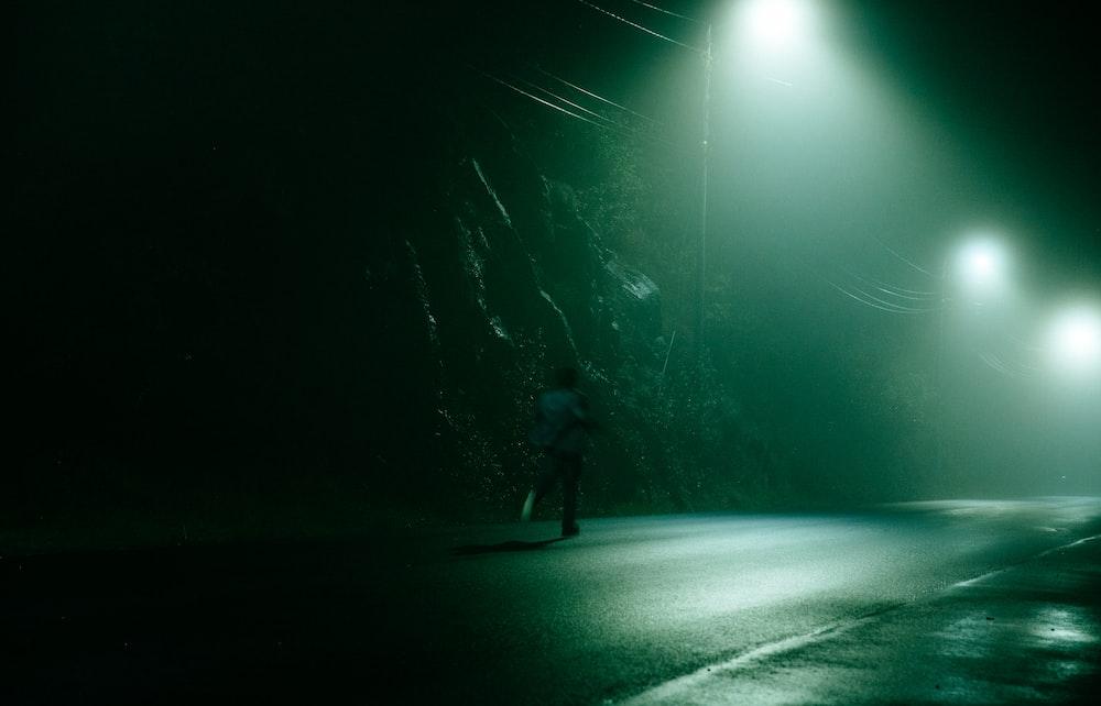 man running on road at night