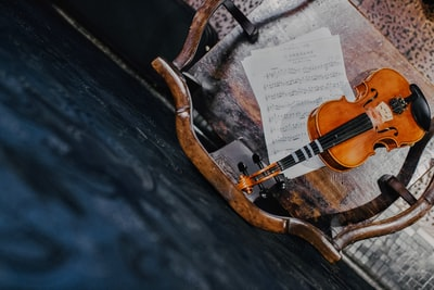brown violin on paper violin zoom background