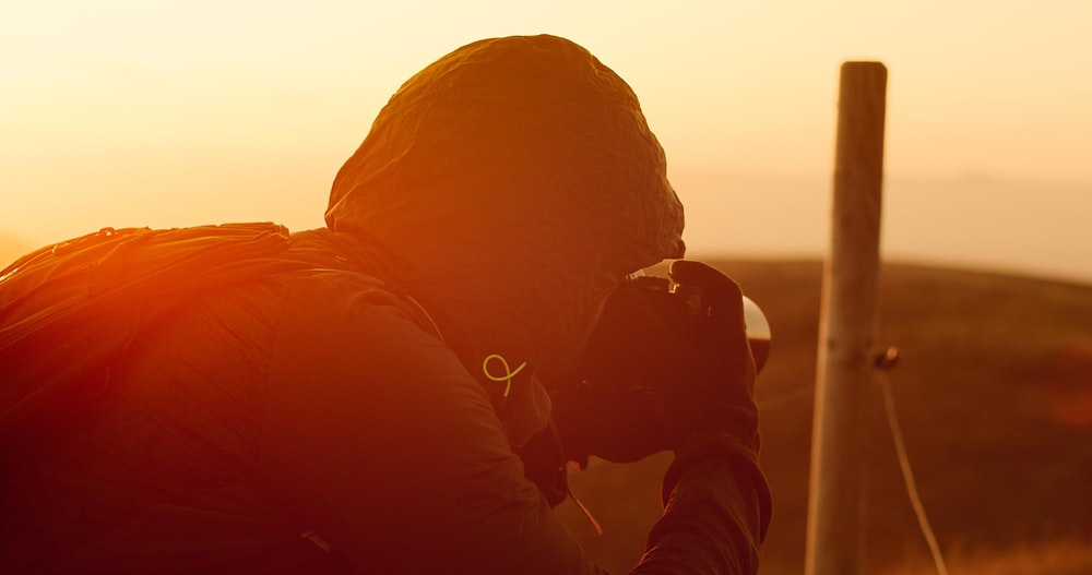 man taking shots during golden hour