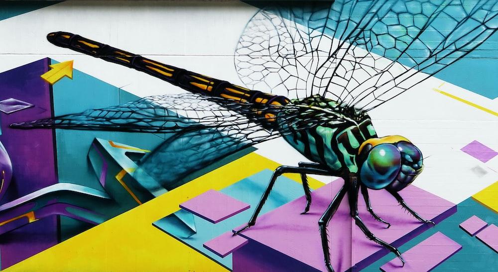 blue and orange dragonfly illustration