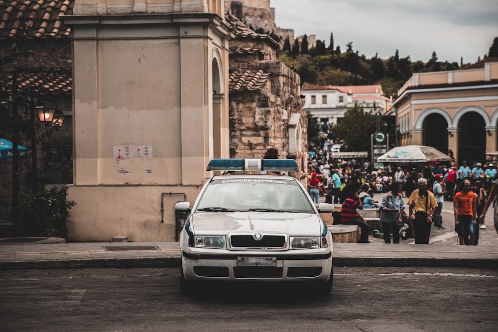 white police car on street