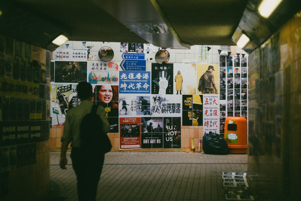 person walking towards wall art