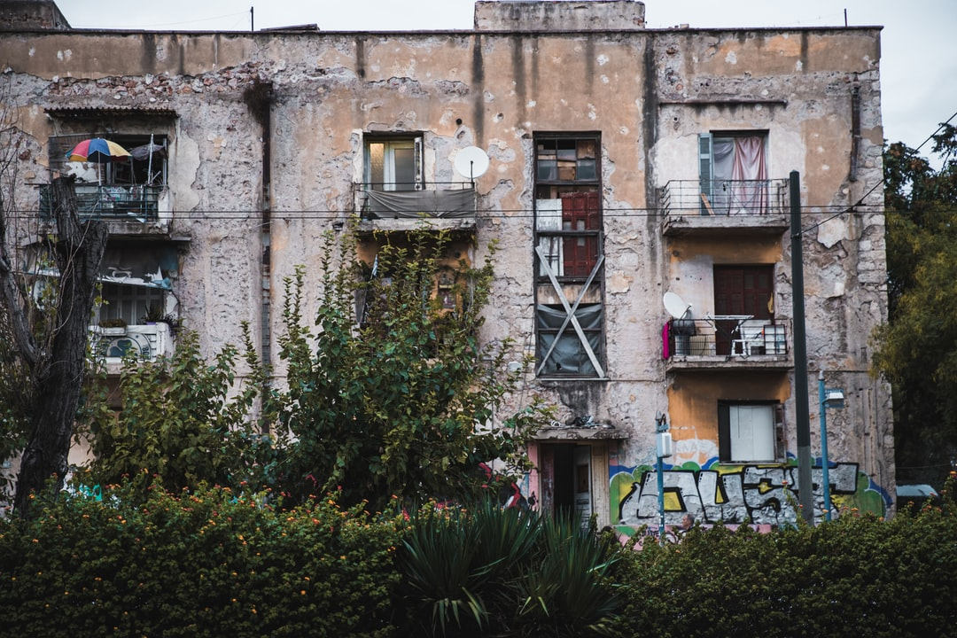 An old apartment building in Athens, Greece that still has people living inside of it. I remember seeing this building every time I visited Athens, even as a young child! If you live in Athens, you for sure know this building!  Shot & Edited By @VisualsByRoyalZ