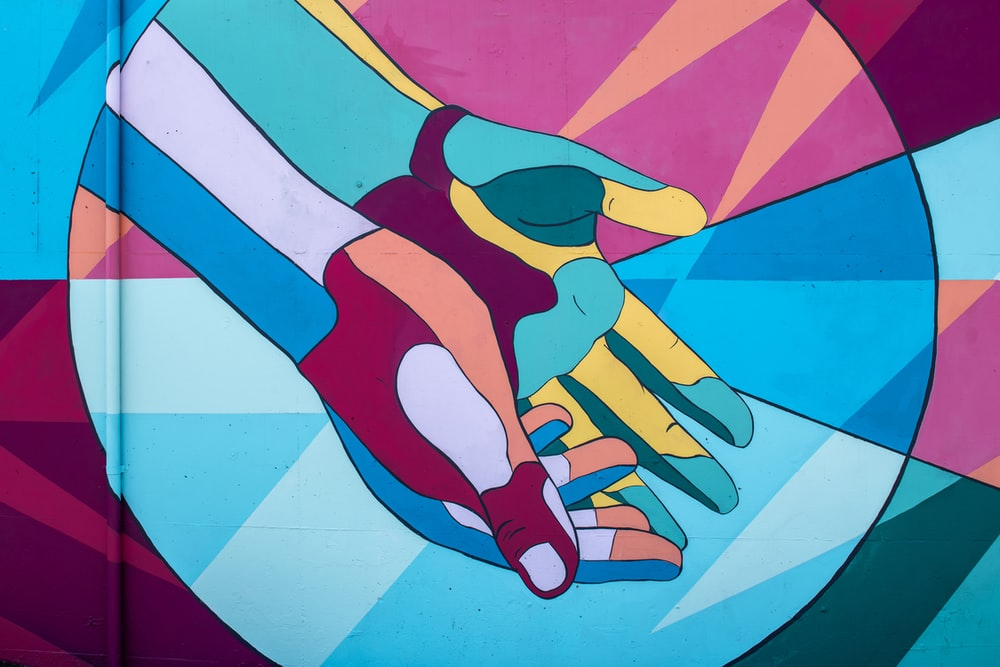 pair of hands painting