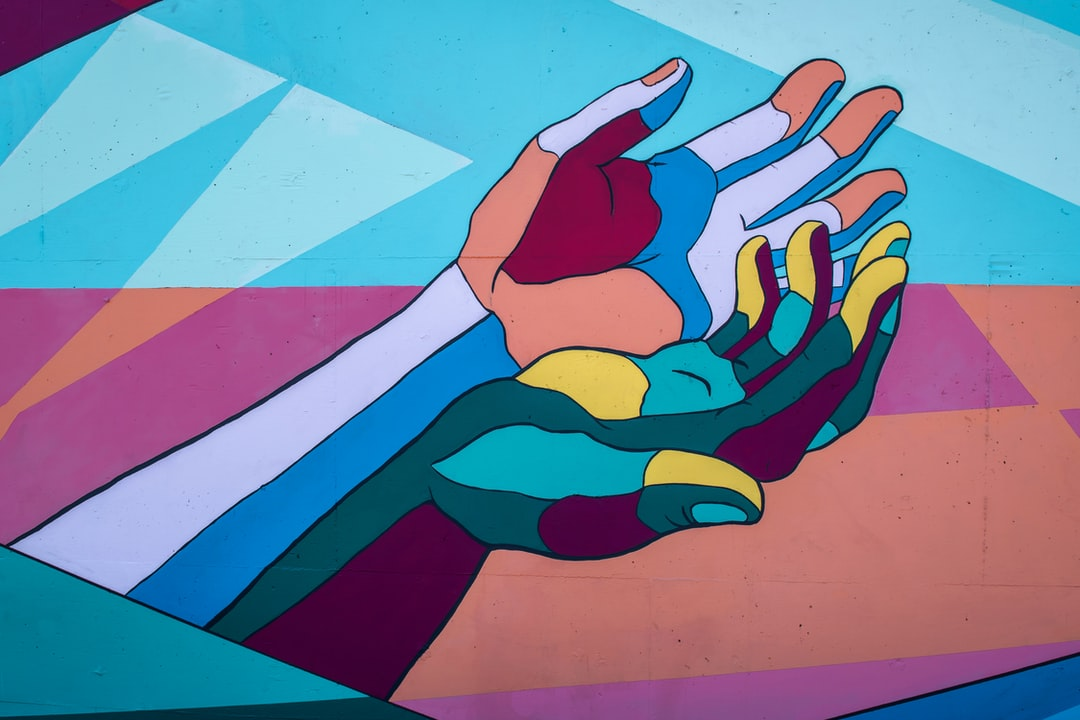 Colorful Hands 2 of 3   /   George Fox students Annabelle Wombacher, Jared Mar, Sierra Ratcliff and Benjamin Cahoon collaborated on the mural.   /   Article: https://www.orartswatch.org/painting-the-town-in-newberg/
