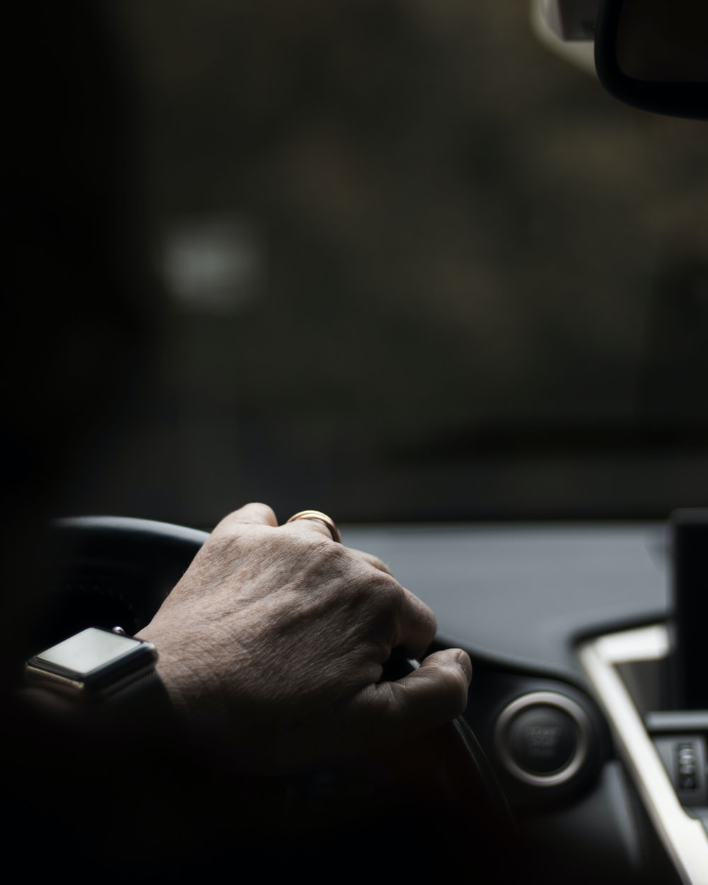 person gripping on steering wheel