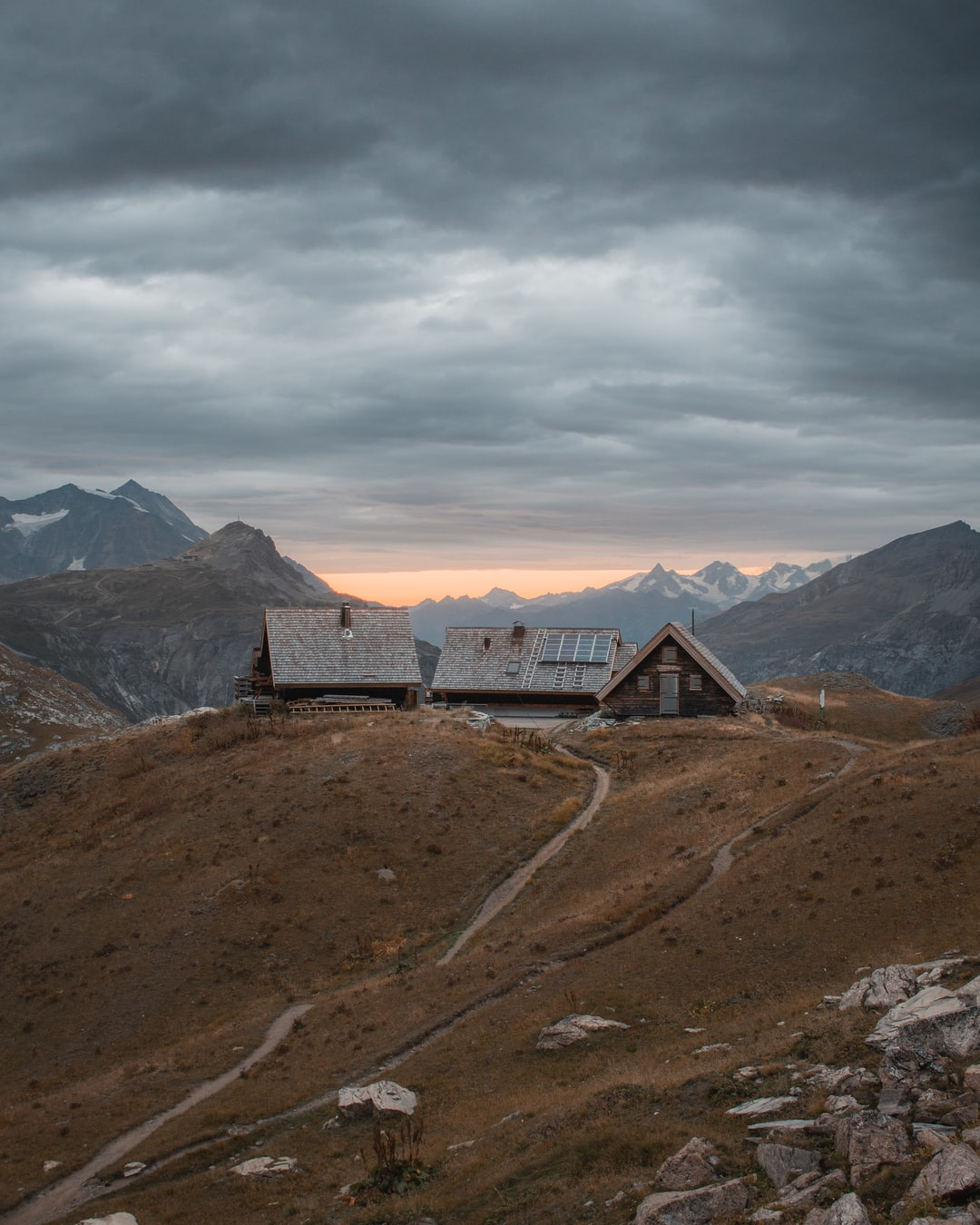 Brown House On High Ground Under Gray Sky Photo