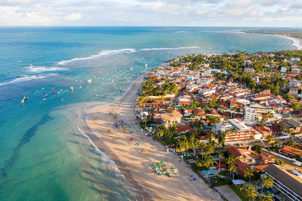 aerial photo of houses near beach