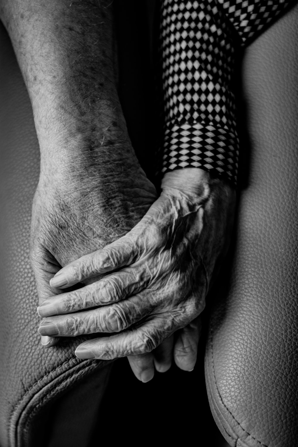 grayscale photography of human hands