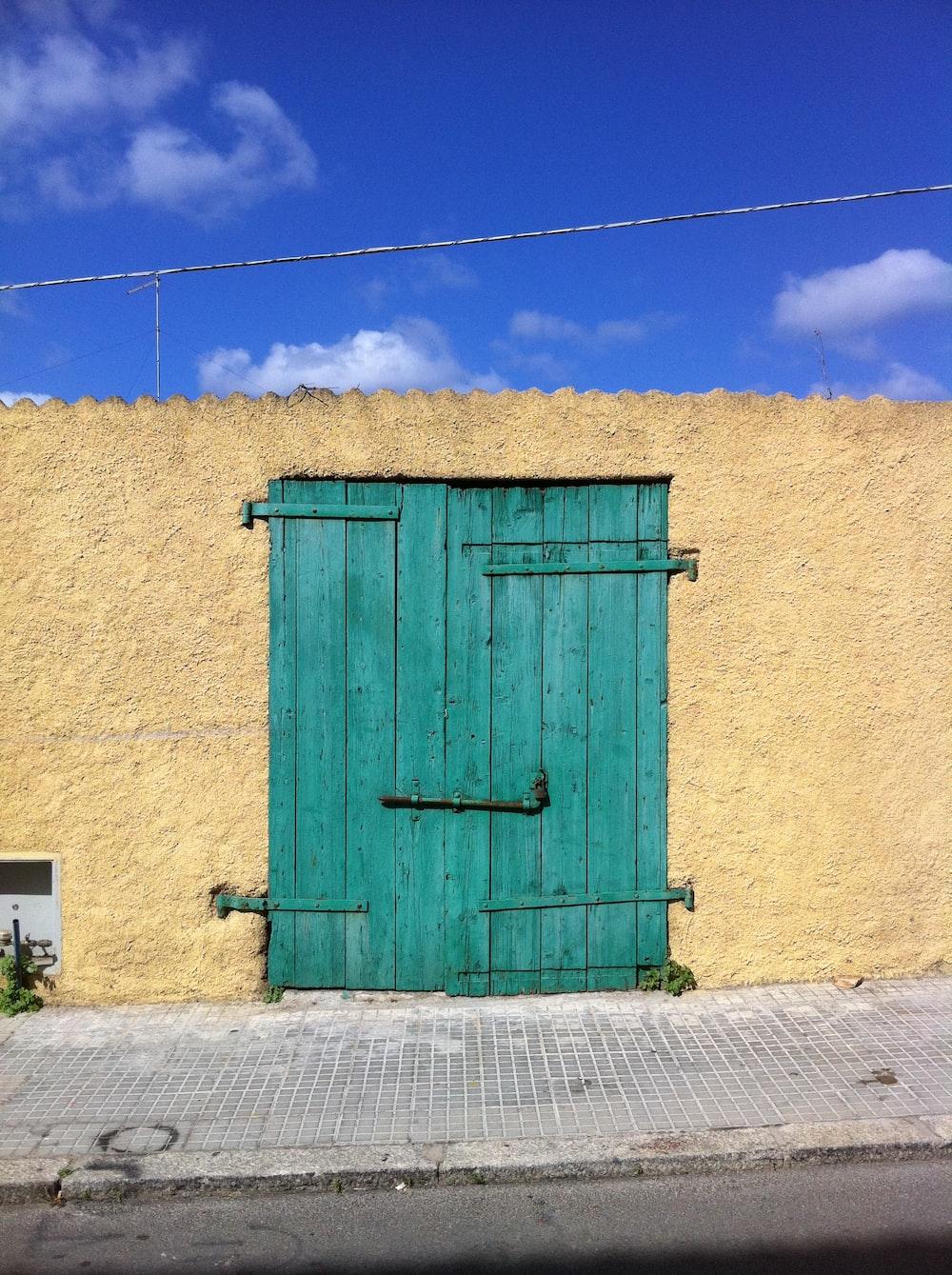 minimalist photography of blue wooden door