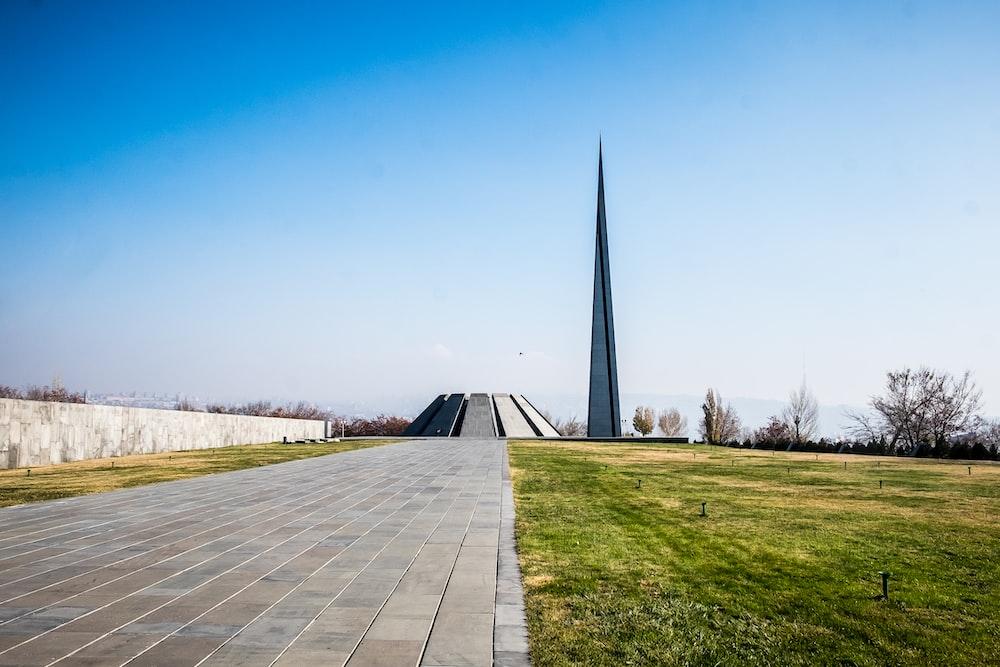 green grass near monument
