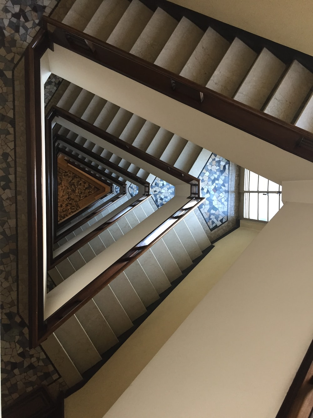 white wooden spiral stairs inside building