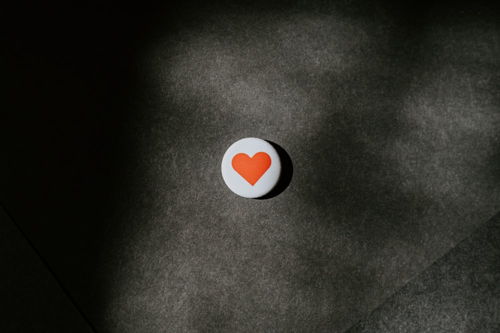 round white and red heart button-pin