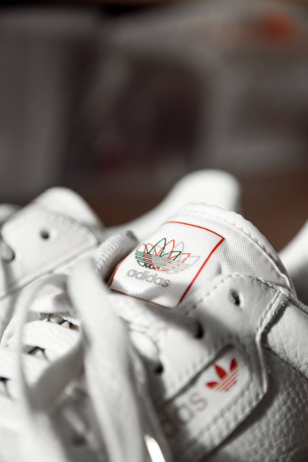closeup photo and seletive focus photography of Adidas sneakers