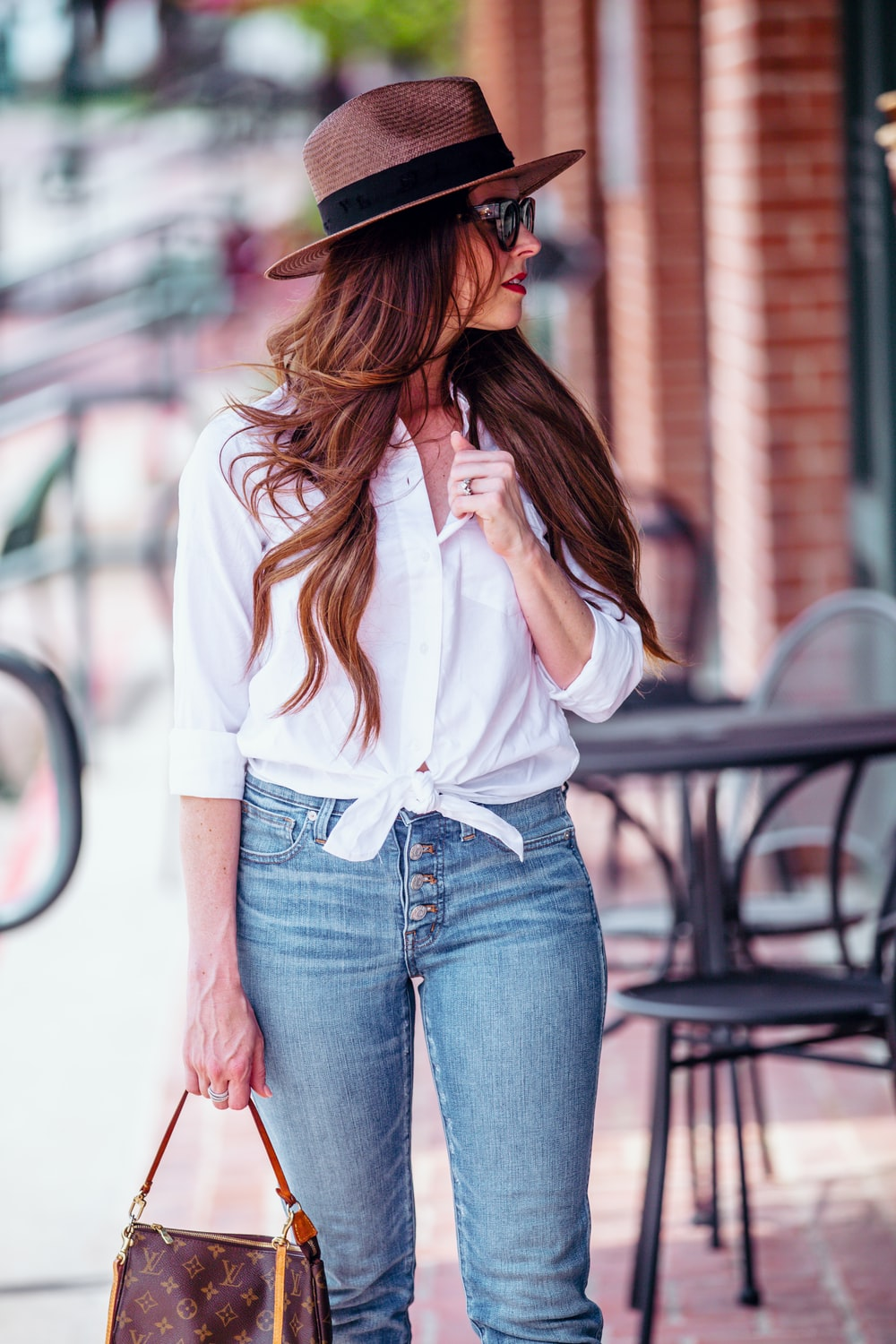 women's white dress shirt and blue jeans