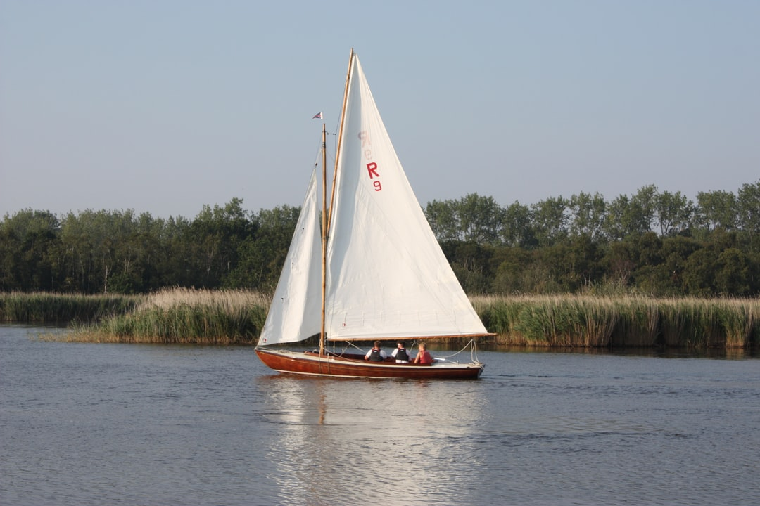 Yachting on Horsey Mere in late summer afternoon