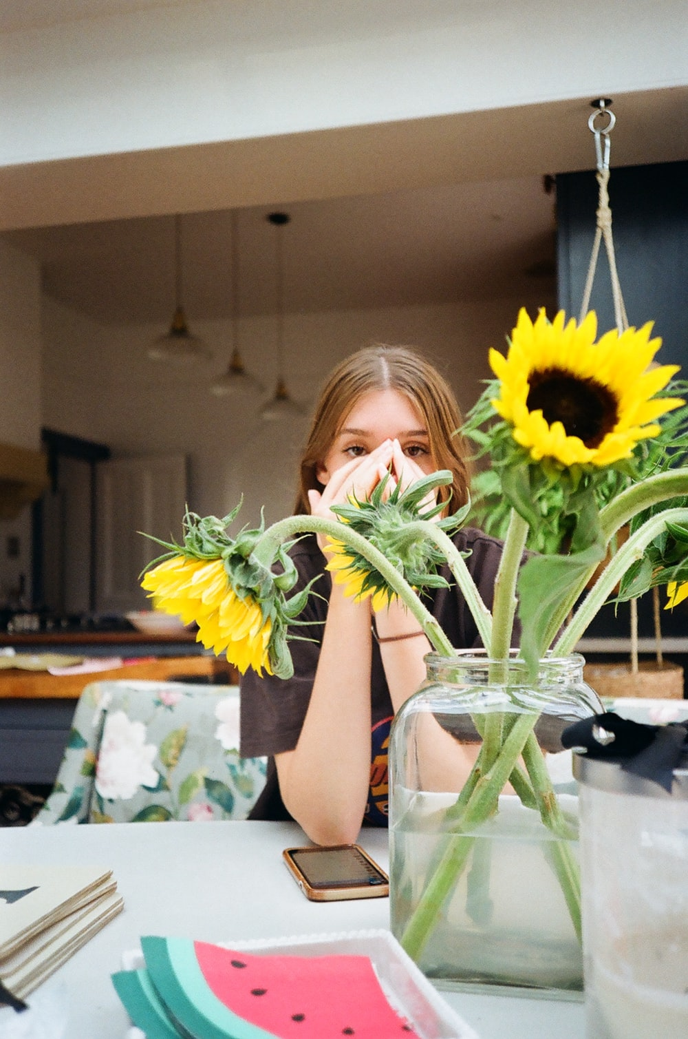 yellow sunflowers beside girl