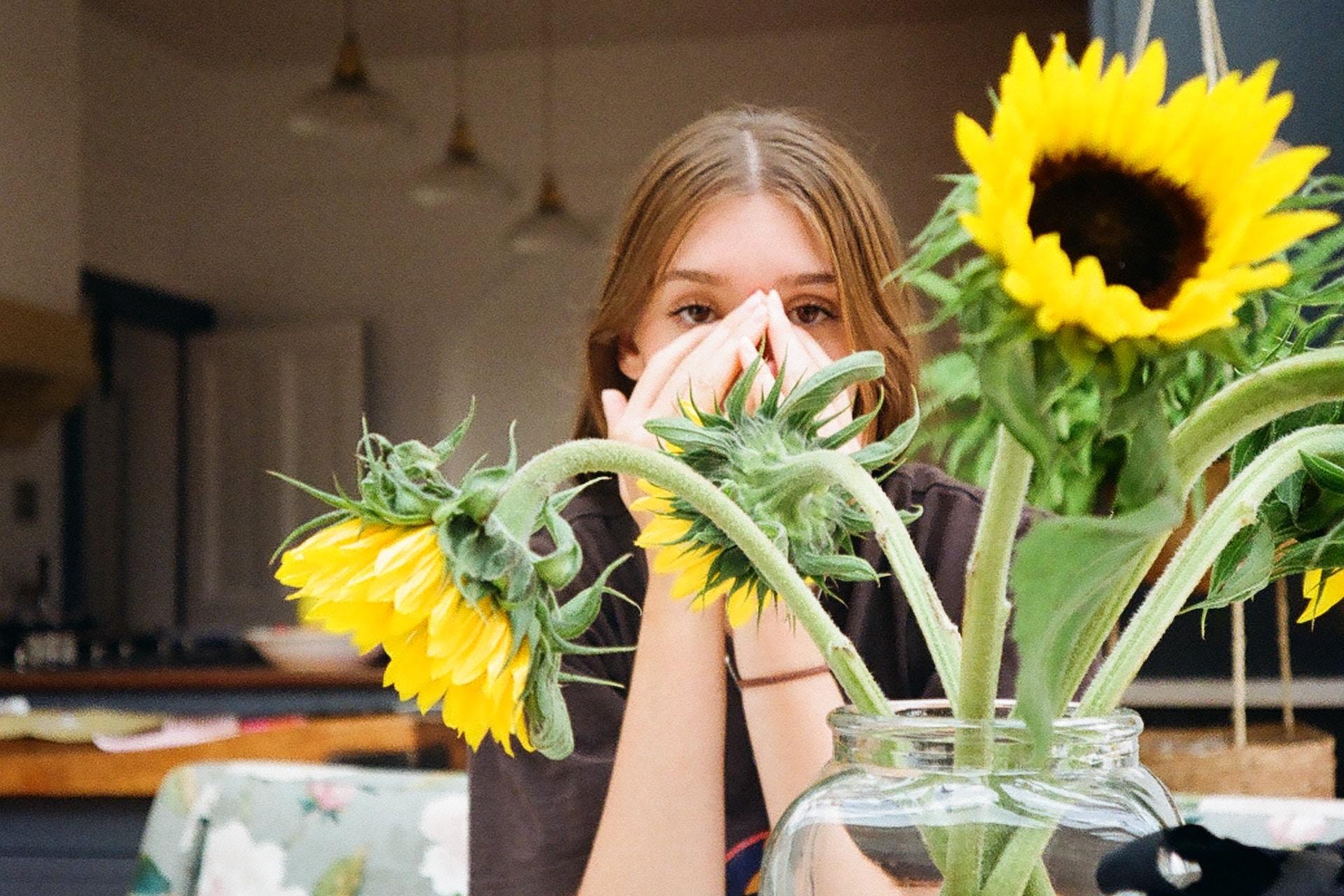yellow sunflowers beside girl