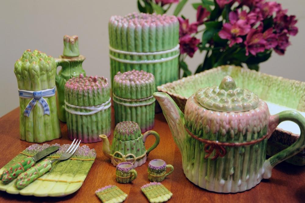 green tea set on brown wooden surface
