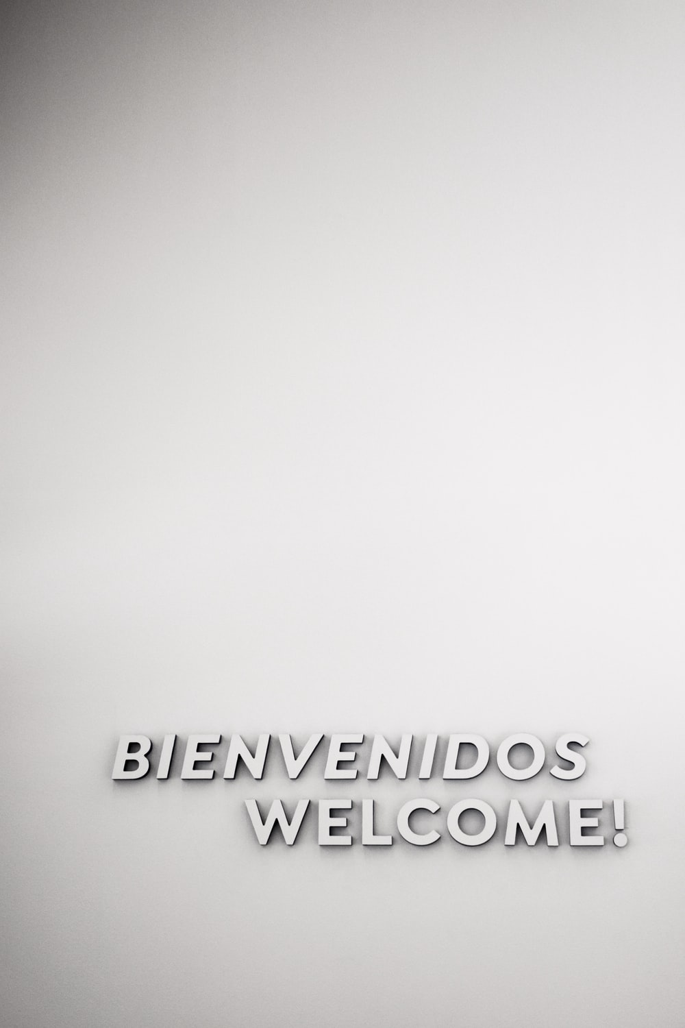white Welcome text
