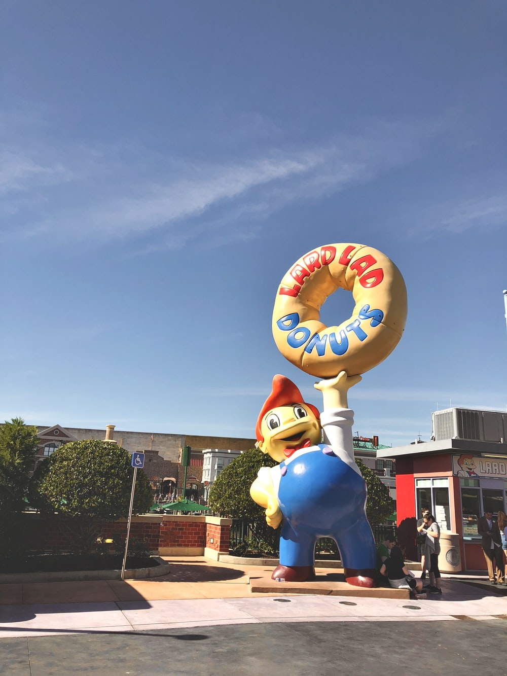 blue and white character carrying doughnut statue