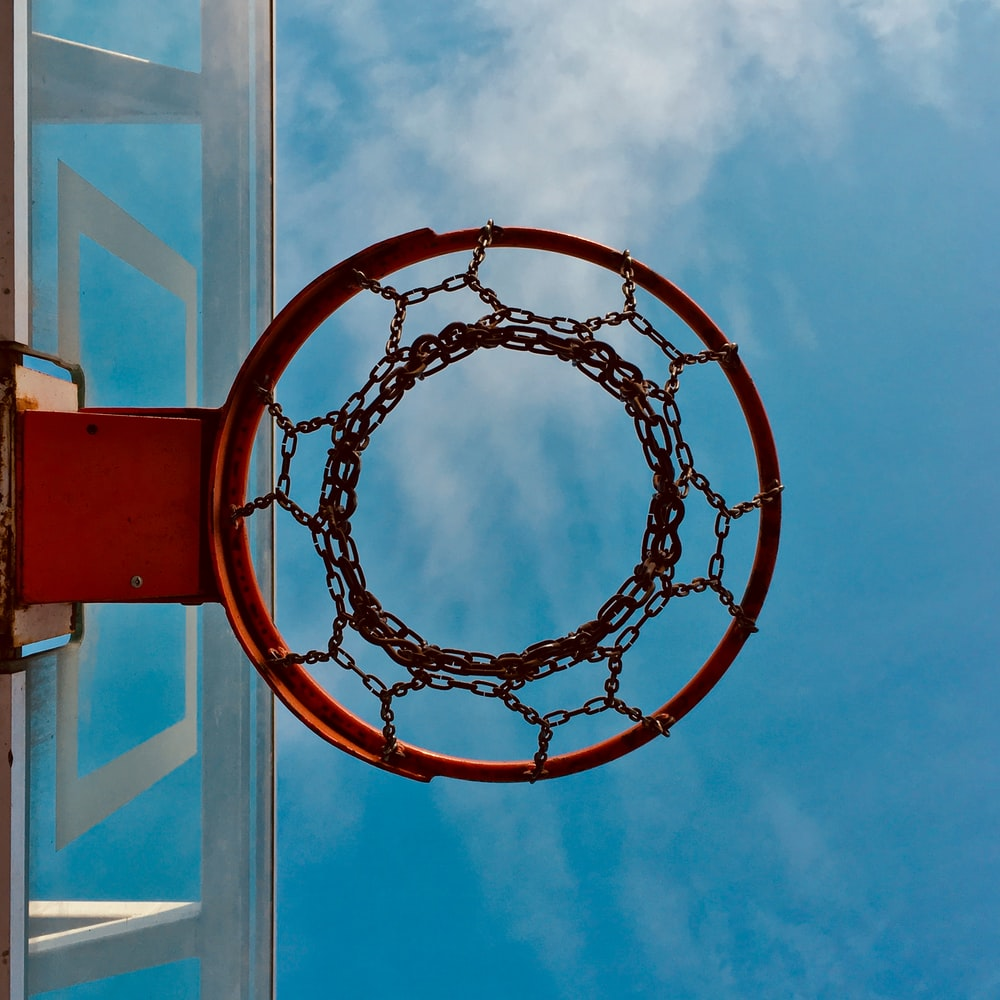 red and black basketball hoop close-up photography