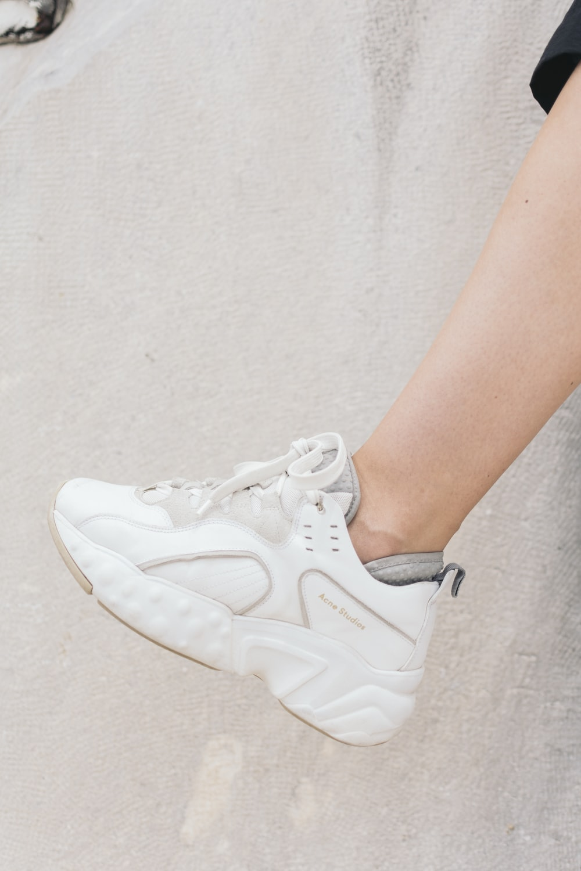 unpaired white shoe