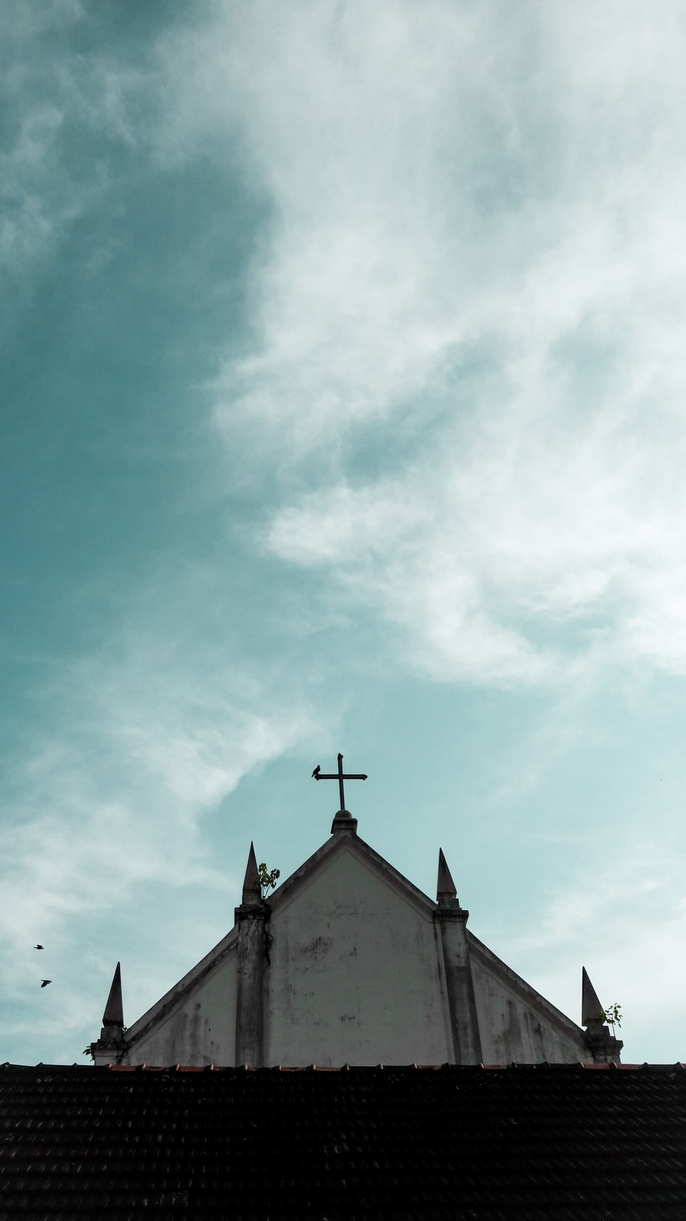 low angle photography of white concrete church
