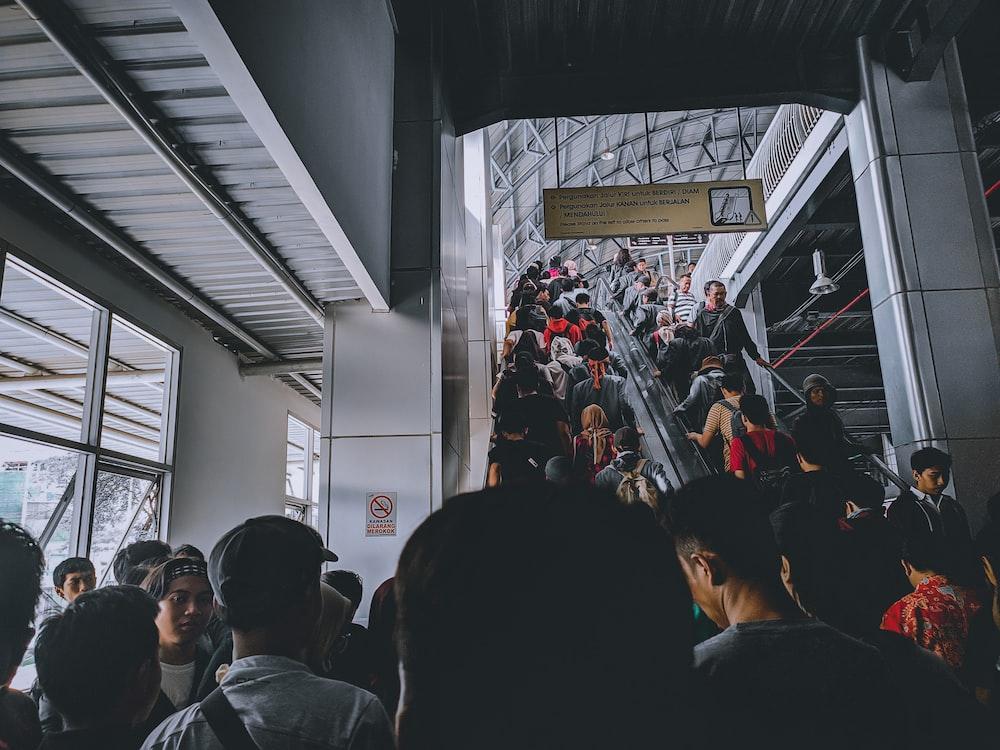 people walking up on escalator