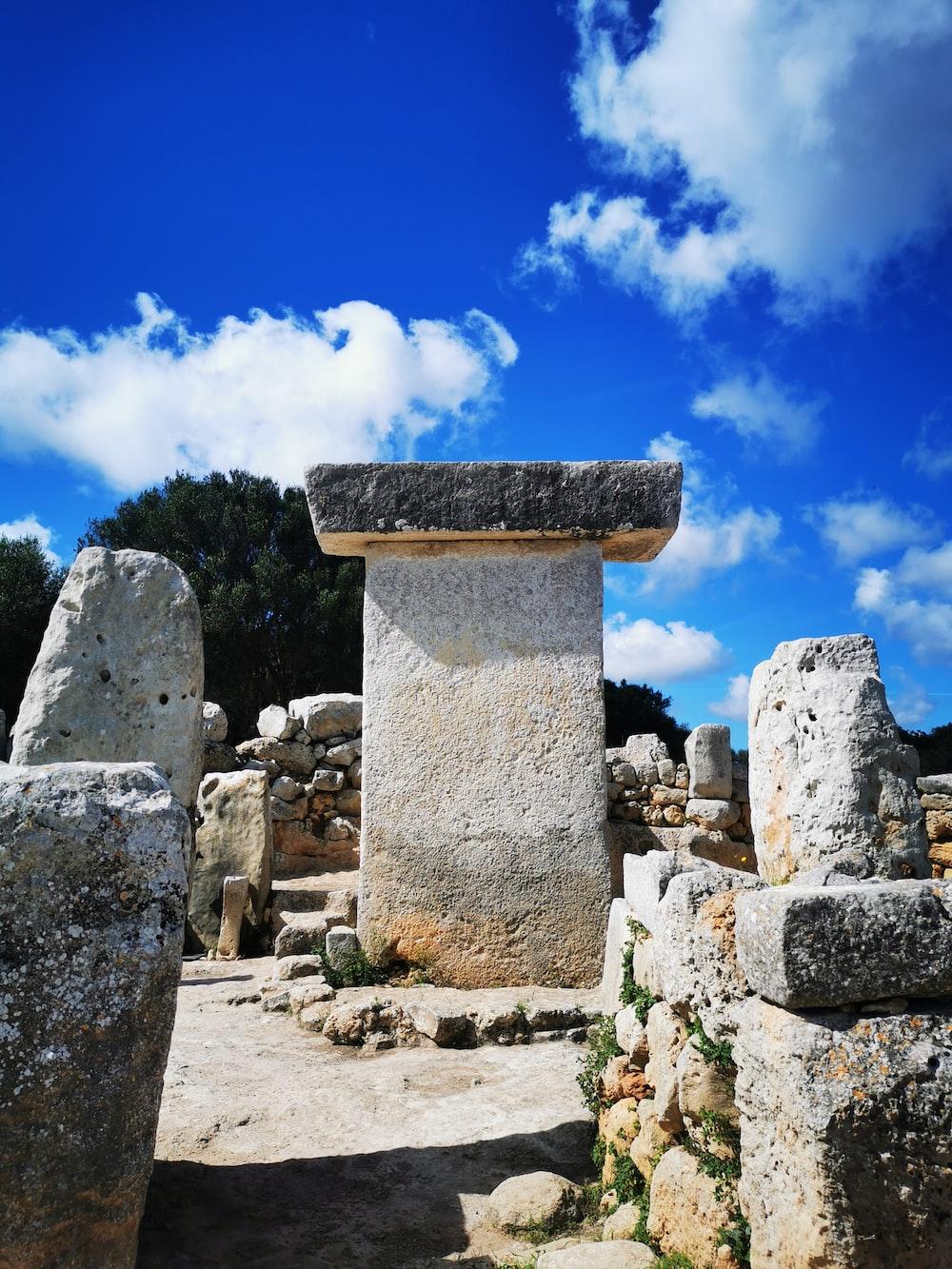 concrete ancient ruins under blue sky